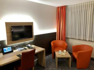 A television and/or entertainment center at Hotel Merkur
