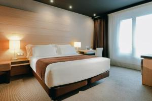 A bed or beds in a room at Hesperia Bilbao