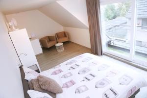 Een bed of bedden in een kamer bij B&B Intermezzo