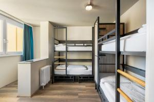 A bunk bed or bunk beds in a room at a&o Prague Metro Strizkov