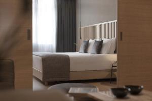 Łóżko lub łóżka w pokoju w obiekcie Porto Palace Hotel Thessaloniki