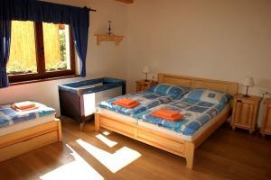 Postel nebo postele na pokoji v ubytování Chalupa Bella