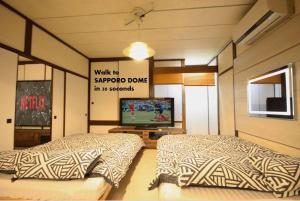 札幌ドーム前ハウス Sapporodome front houseにあるベッド