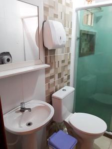 Um banheiro em Hostel & Suites Caravela