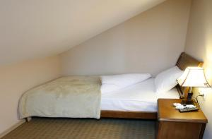 A bed or beds in a room at Abu Hotel