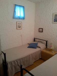 A bed or beds in a room at Casa Vacanza Le Roches
