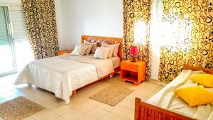 Un ou plusieurs lits dans un hébergement de l'établissement Mahdia Place Apartments