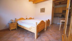 A bed or beds in a room at Landgasthof Scherer