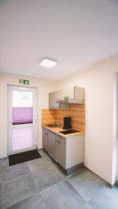 A kitchen or kitchenette at Landgasthof Scherer