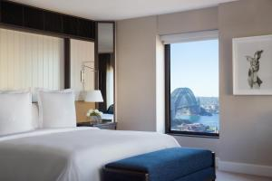 A bed or beds in a room at Four Seasons Hotel Sydney
