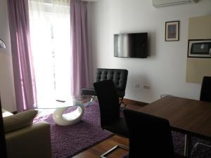 A seating area at Residence Villa Karda