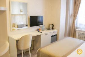 Cama ou camas em um quarto em Ganjali Plaza Hotel