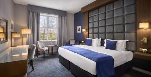 A bed or beds in a room at Radisson BLU Hotel & Spa, Sligo