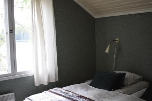 Vuode tai vuoteita majoituspaikassa Pensar Hotelli & Ravintola Sandvik