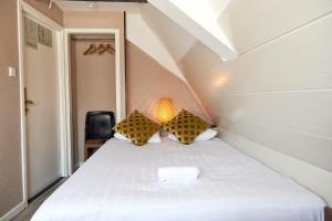 Cama ou camas em um quarto em ITC Hotel