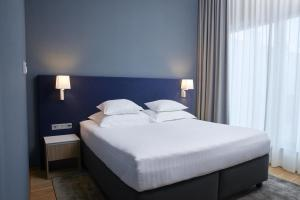 A bed or beds in a room at Tallink Spa & Conference Hotel