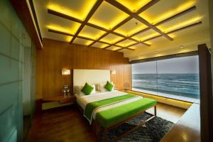 A bed or beds in a room at The Gold Beach Resort