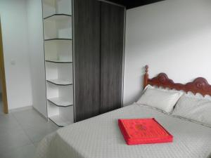 A bed or beds in a room at Aconchego e Requinte no Centro