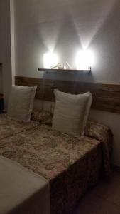 Cama o camas de una habitación en Habitacion con baño privado