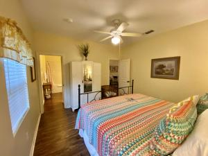 A bed or beds in a room at Comal Inn
