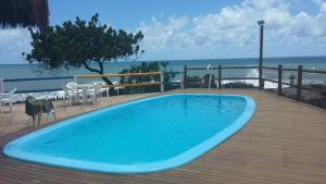 The swimming pool at or near Flat Olivença - Ilhéus