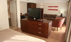 A television and/or entertainment center at Grand King Hotel
