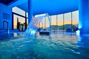 The swimming pool at or near Seehotel Pilatus