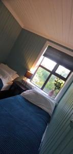 Cama o camas de una habitación en Prestshús 2 Guesthouse