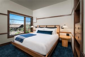 A bed or beds in a room at Pronghorn Resort