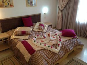 A bed or beds in a room at Appart Hotel Rodes