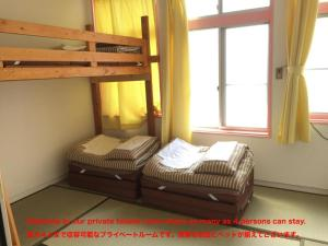 A bunk bed or bunk beds in a room at Beppu Guest House