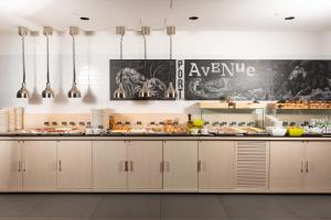 A kitchen or kitchenette at AZIMUT Hotel Vladivostok