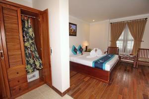 A bed or beds in a room at Novela Muine Resort & Spa