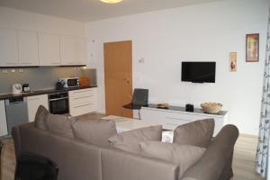 A seating area at Apartments Klinovec