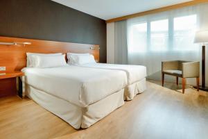 Cama o camas de una habitación en Hesperia Donosti