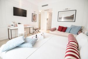 A bed or beds in a room at Hotel Baglio Basile
