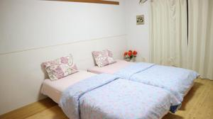 A bed or beds in a room at Residence Uni awaza