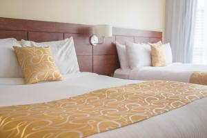 A bed or beds in a room at Hotel Continental Altamira