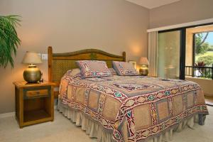 A bed or beds in a room at Makena Surf, a Destination by Hyatt Residence