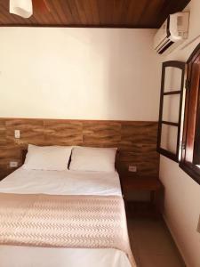 A bed or beds in a room at Pousada Bem Viver