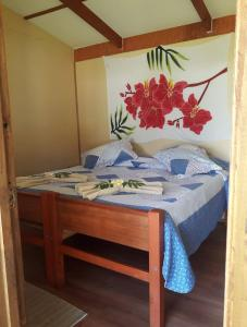 A bed or beds in a room at Camping y Hostal Tipanie Moana