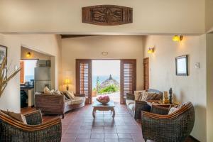 Uma área de estar em Pelican Villa