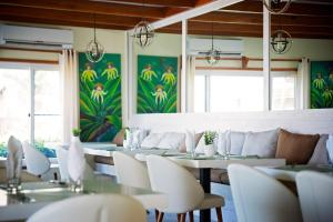 A restaurant or other place to eat at Belizean Dreams Resort