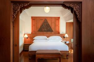 A bed or beds in a room at Hilton Phuket Arcadia Resort & Spa