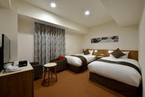 那霸格雷塞里酒店房間的床