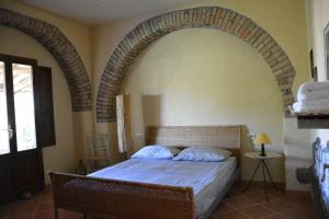 Letto o letti in una camera di Agriturismo San Agostino