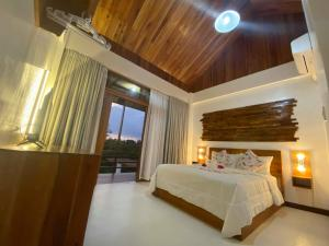 A bed or beds in a room at Ananda Resort