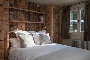 A bed or beds in a room at Appartement Flocon de Nell