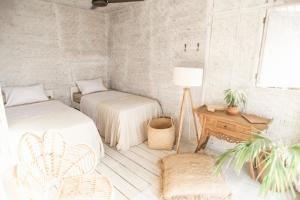 A bed or beds in a room at Dreamsea Bali