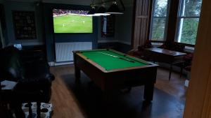 A billiards table at The Ginger Hall Hotel